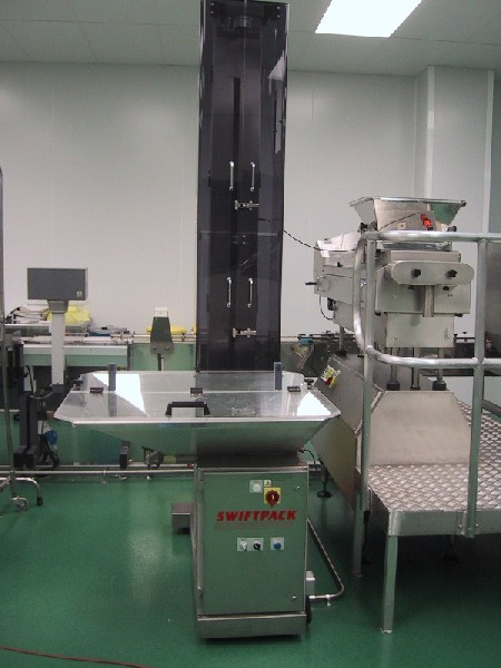 Complete line for counting and filling tablets & capsules into plastic containers
