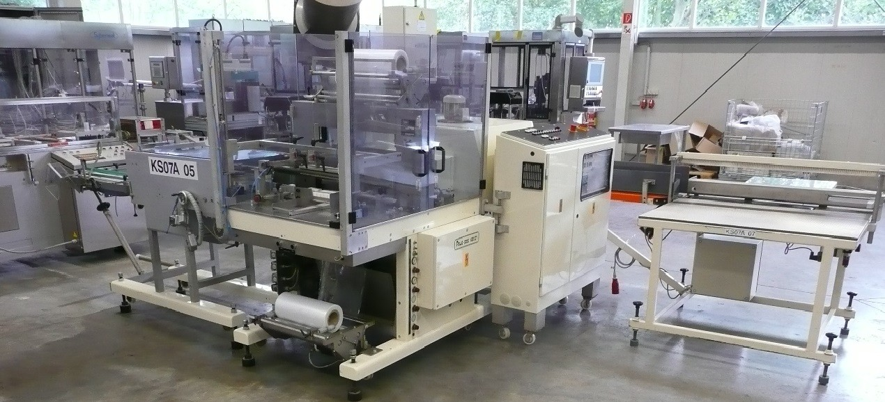 Pester Pewo-Pack 450SN collator bundler for cartons, with stacking/collation unit and shrink tunnel