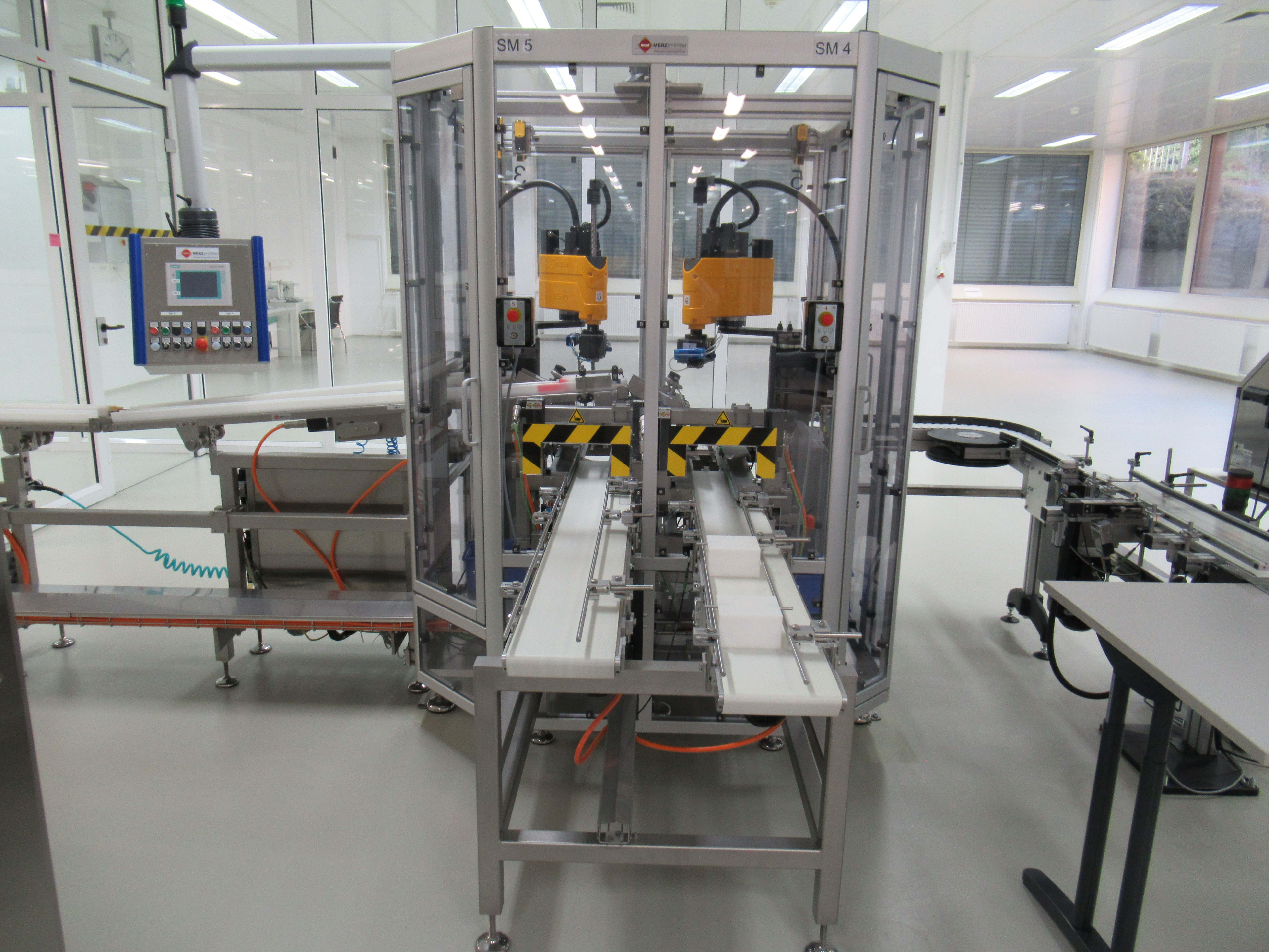 Merz KT160 semi-automatic packing line for packing sticks into pre-folded cartons